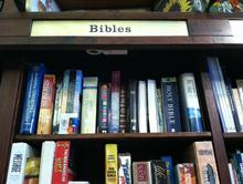 bibles on a bookshelf